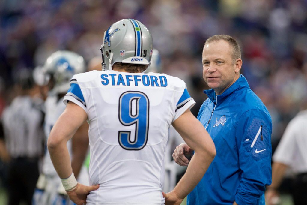 Dec 29, 2013; Minneapolis, MN, USA; Detroit Lions offensive coordinator Scott Linehan talks with quarterback Matthew Stafford (9) before the game with the Minnesota Vikings at Mall of America Field at H.H.H. Metrodome. The Vikings win 14-13. Mandatory Credit: Bruce Kluckhohn-USA TODAY Sports ORG XMIT: USATSI-133054