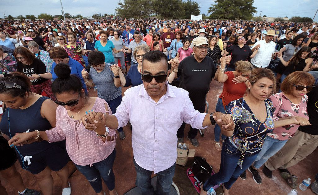 People joined hands and prayed during the Hope Border Institute prayer vigil in El Paso on Aug. 4, a day after a mass shooting at a Walmart store. The largely Hispanic city of El Paso has deep roots in Catholicism and religion in general. After the massacre that left more than 20 dead and many others injured, residents are turning to their faith to get through these times.