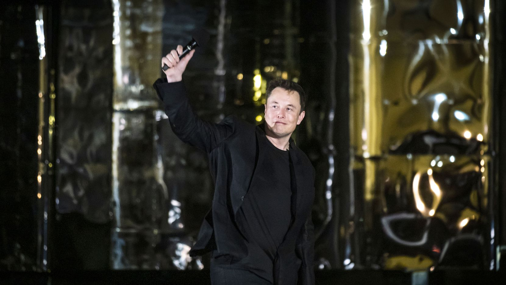 SpaceX founder Elon Musk makes a presentation in front of a prototype of the Starship spacecraft at the SpaceX Space Launch Facility in Boca Chica, Texas, on Saturday, Sept. 28, 2019.