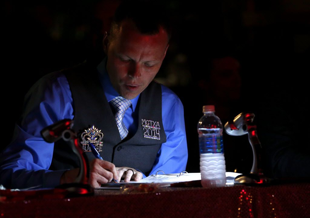 Judge Dessie Love-Blake takes notes during the Miss Gay Texas America preliminary round at Station 4 in Dallas on Wednesday, July 20, 2016 (Rose Baca/The Dallas Morning News)