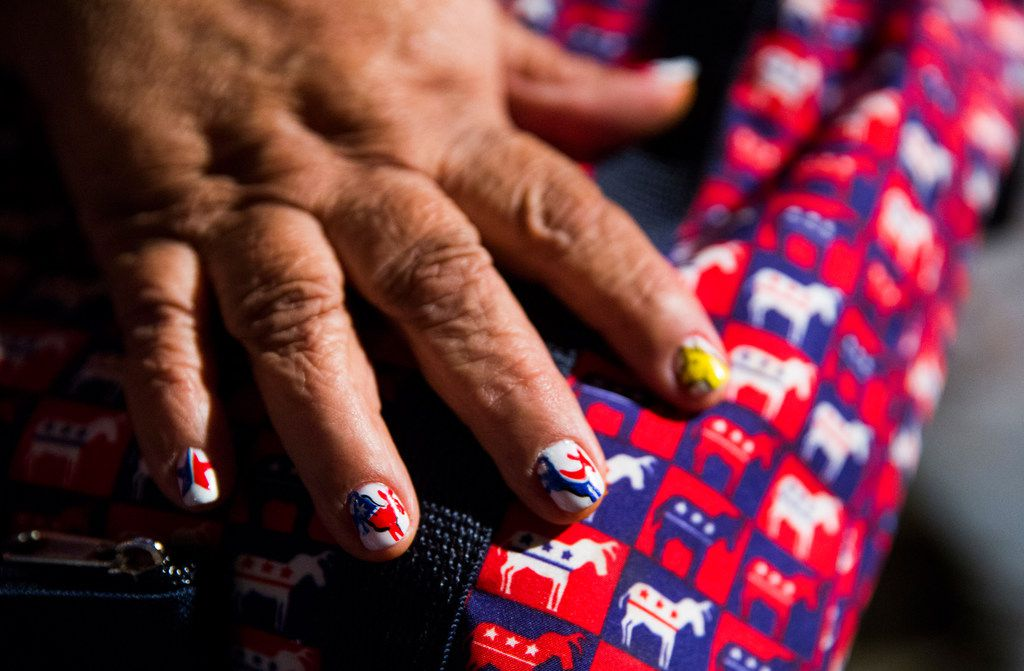 Carmen Duron of Corpus Christi, Texas shows off her custom nail art during the Texas Democratic Convention on Friday, June 22, 2018 at the Fort Worth Convention Center in Fort Worth. (Ashley Landis/The Dallas Morning News)