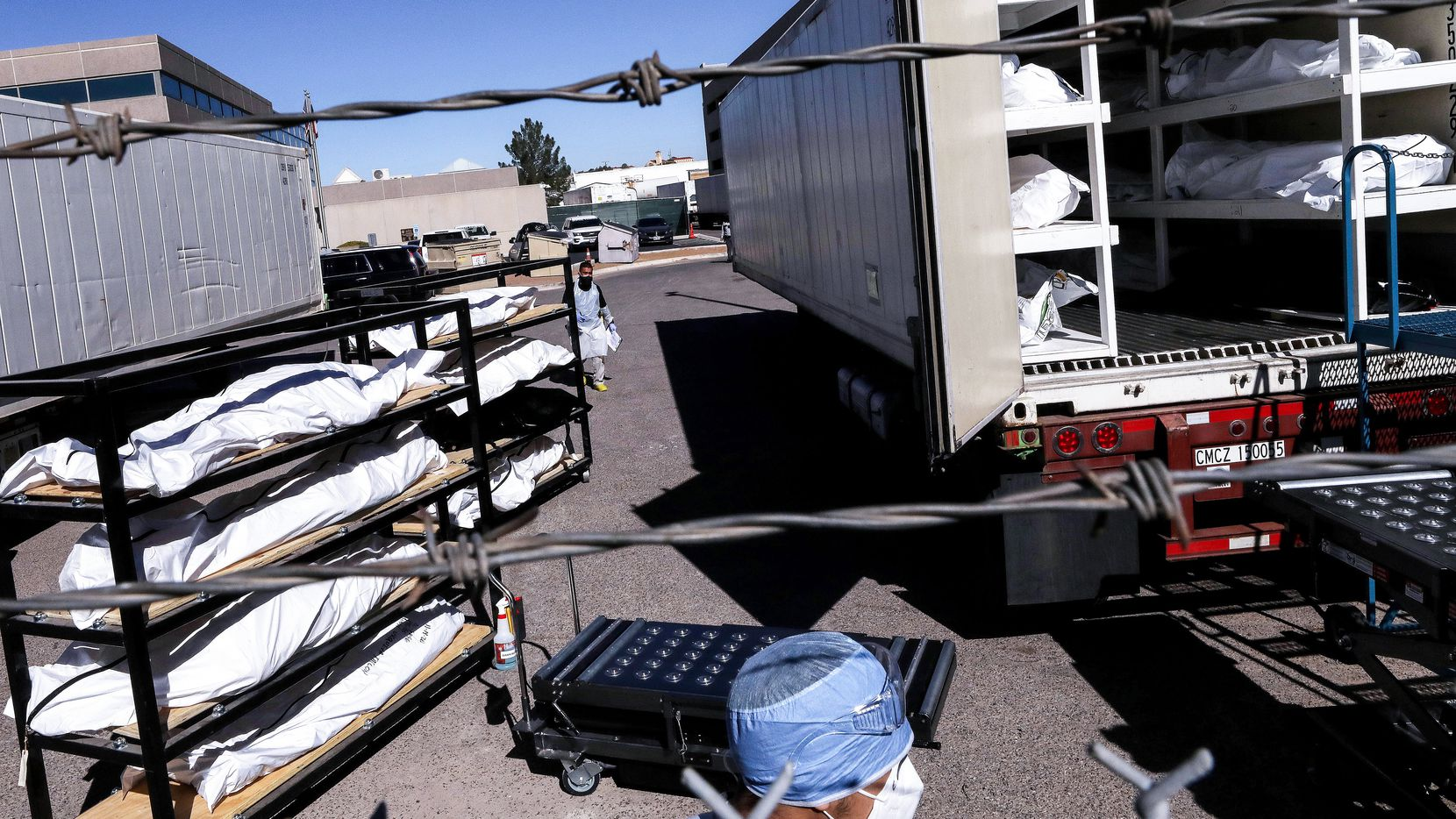 A worker prepares corpses for refrigeration trailers that served as temporary morgues in El Paso County during the darkest days of the pandemic.