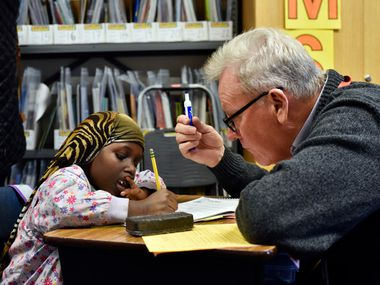 First grader Halima Hassan works with volunteer Gerald Fogarty on English spelling and reading during a program for refugee students at Lee A. McShan Jr., elementary school in Dallas, on Dec. 15, 2016. Ben Torres/Special Contributor