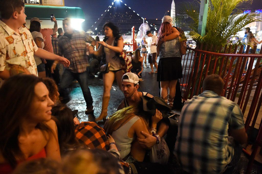 People run for cover at the Route 91 Harvest country music festival after a gunman began firing on the crowd. (David Becker/Getty Images)