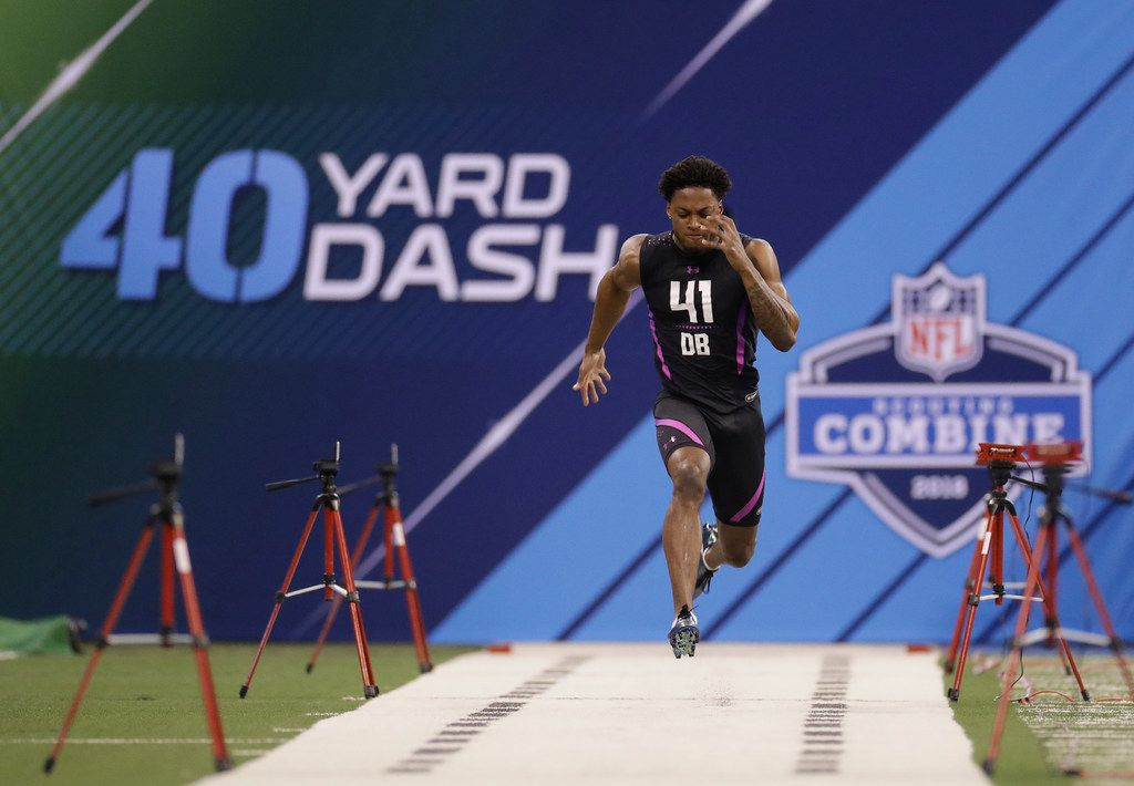 Ohio State defensive back Denzel Ward runs the 40-yard dash during the NFL football scouting combine, Monday, March 5, 2018, in Indianapolis. (AP Photo/Darron Cummings)