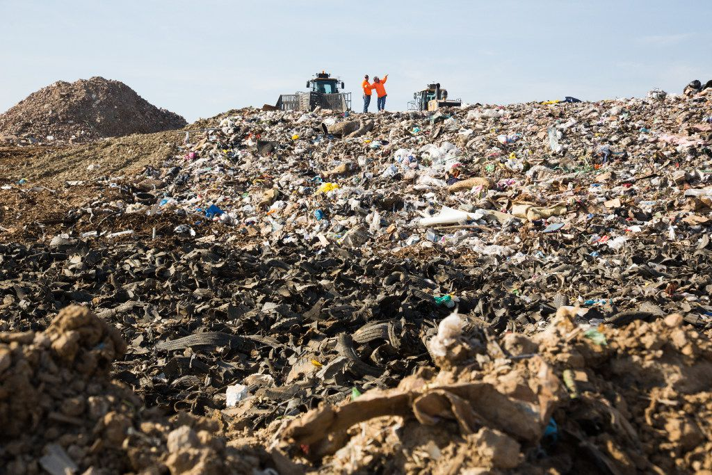 The two workers stand on top of a hill of garbage in landfill section at ECO-W.E.R.C.S. Resource Recovery Park, Friday, February 10, 2017, in Denton, Texas, Jeff Woo/DRC