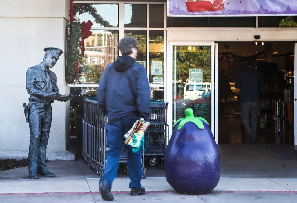 A statue of a police officer stands in front of Central Market on Lovers Lane in Dallas. A Curious Texas reader asked about the history behind the statue.
