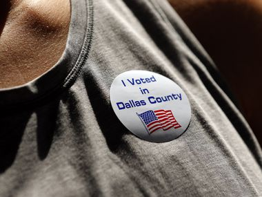A voter wore a sticker showing others that she voted early in the Nov. 3rd general election at University Park United Methodist Church in Dallas, Tuesday, October 13, 2020. (Tom Fox/The Dallas Morning News)