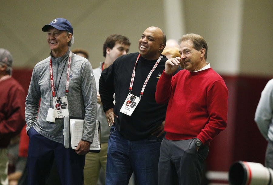 FILE - Cowboys scout Walter Juliff (left), Vikings defensive coordinator George Edwards (center) and Alabama head coach Nick Saban talk during Alabama pro day on Wednesday, March 7, 2018, in Tuscaloosa, Ala. (AP Photo)