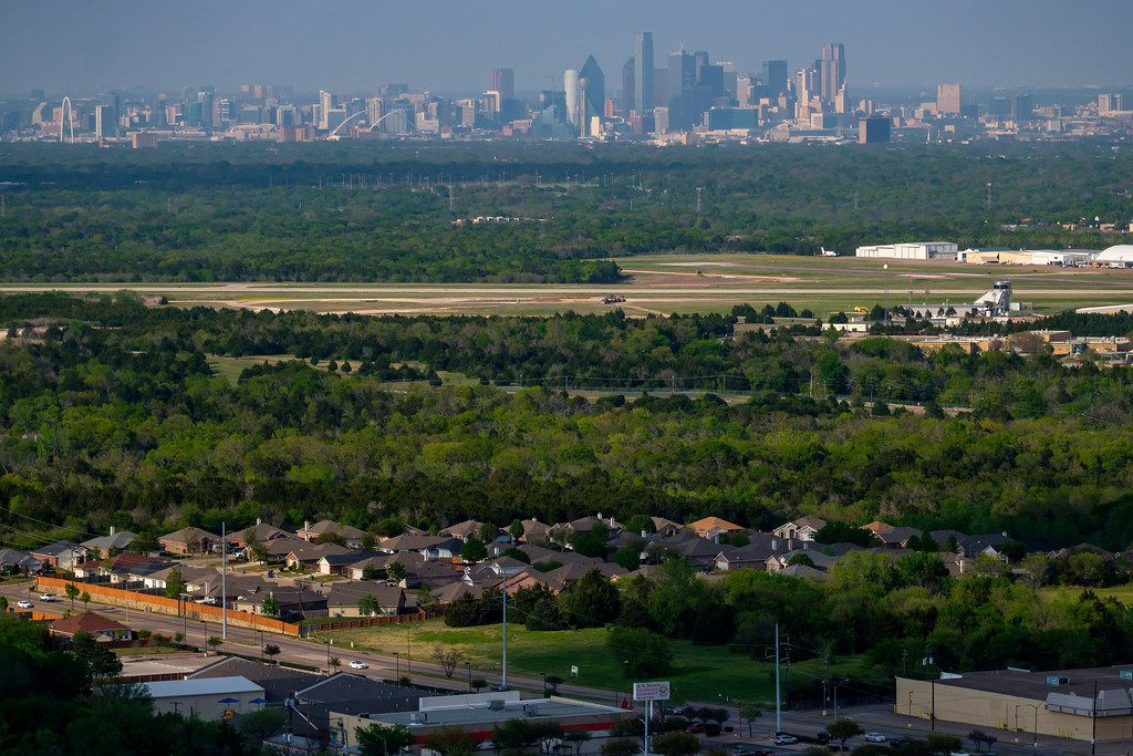The downtown skyline is seen over Dallas Executive Airport and homes in the Red  Bird area on April 4, 2019, in Dallas. Downtown had nonresponse rate of 36% in 2010, while in parts of Red Bird only half of the households responded.