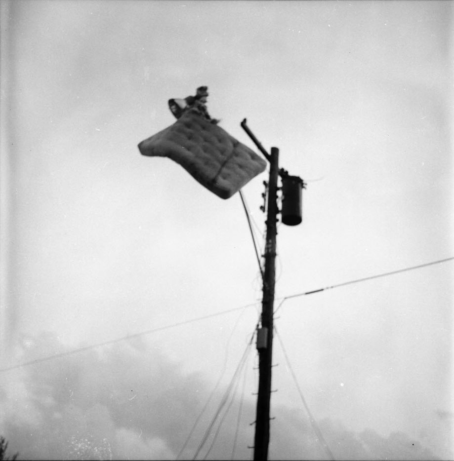 High winds from the 1957 storm whipped mattress onto a utility pole in Dallas.