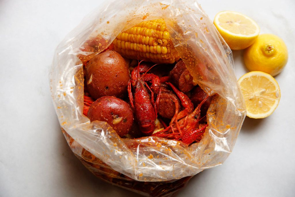Crawfish, potatoes, corn and sausage photographed at The Boiling Crab in Dallas.