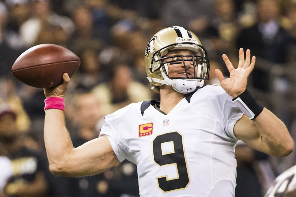 New Orleans Saints quarterback Drew Brees (9) throws a pass during the first half of an NFL football game against the Dallas Cowboys at the Mercedes-Benz Superdome on Sunday, Oct. 4, 2015, in New Orleans.