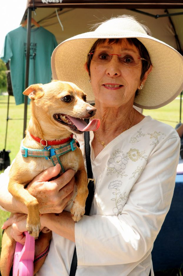 Helen McKinney and her pup Pepe enjoy the 21st annual Dog Day Afternoon at Flagpole Hill in Dallas, TX on June 6, 2015.