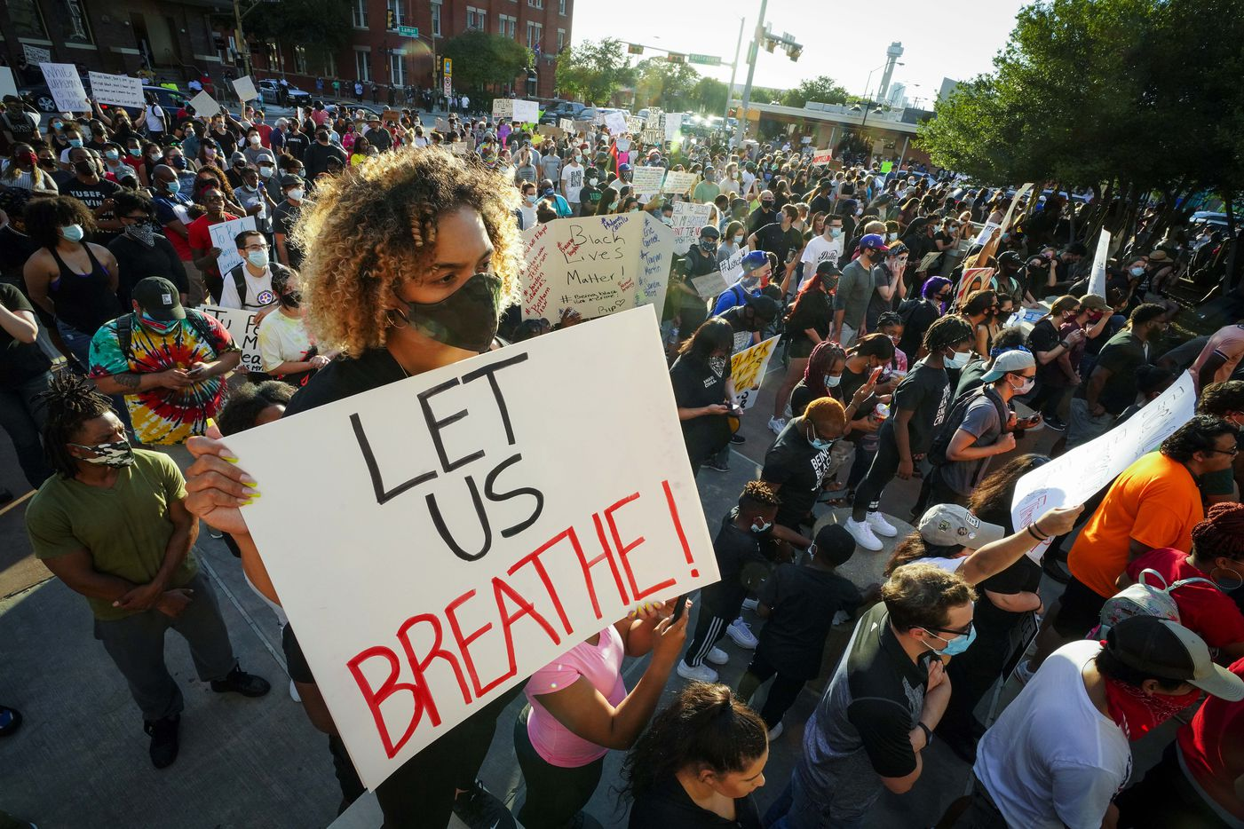Tiona Bowman holds a sign reading ÒLet Us BreatheÓ during a protest against police brutality at the Dallas Police Headquarters on Friday, May 29, 2020, in Dallas.