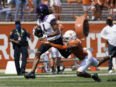TCU wide receiver Quentin Johnston (1) tries to make a catch over Texas defensive back Jalen Green (3) during the first half of a game on Saturday, Oct. 3, 2020, in Austin. (AP Photo/Eric Gay)