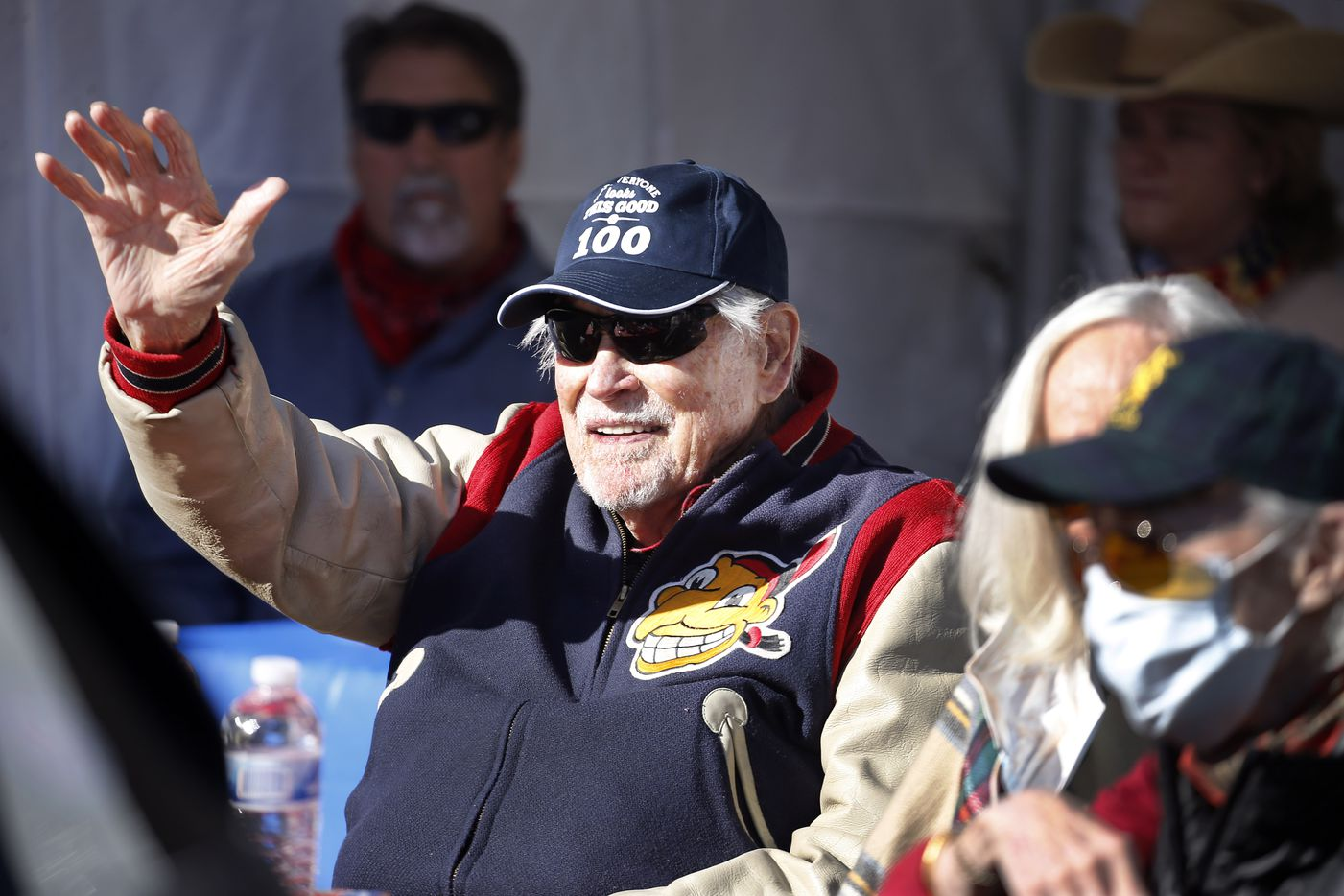 Eddie Robinson, the oldest living former MLB player, waves to friends who delivery an early 100th birthday wish. He will turn 100 on December 15th. To share his birthday with friends, his family orchestrated a drive-by celebration outside his Fort Worth home, Saturday, December 12, 2020. His 65 year career started by playing for the Cleveland Indians and serving in World War II. Later he went on to play for several other teams before presiding over three winning seasons as the Texas Rangers general manager. He is still in great physical health as he waves to passersby, including former teammates, GM Tom Grieve and U.S. congressman and neighbor Marc Veasey. (Tom Fox/The Dallas Morning News)