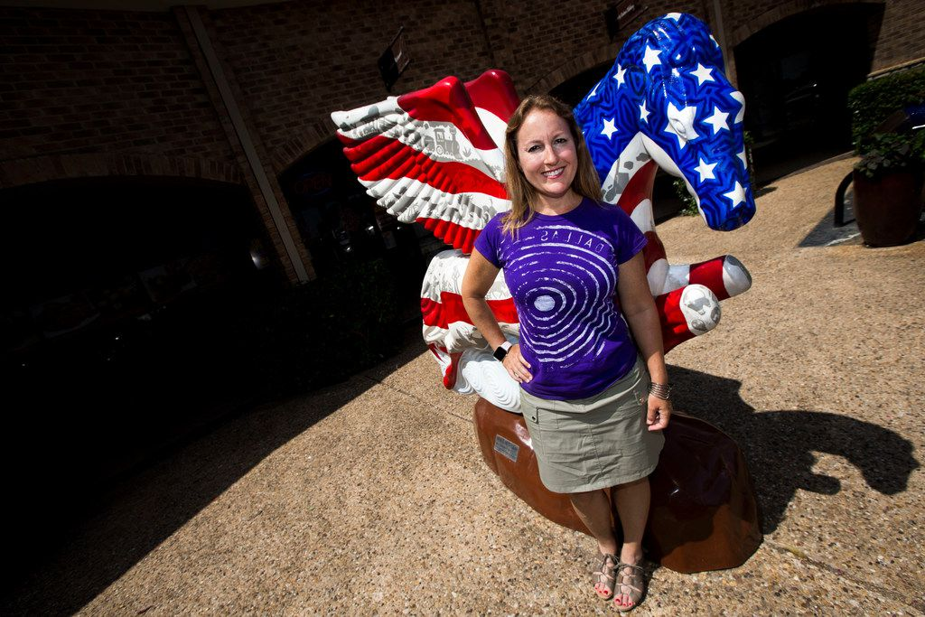 Sheri Hall poses for a portrait in front of a Pegasus sculpture at the Preston Valley Shopping Center in Dallas on July 5, 2018. Hall submitted a question to Curious Texas after noticing the sculptures disappear around the city.
