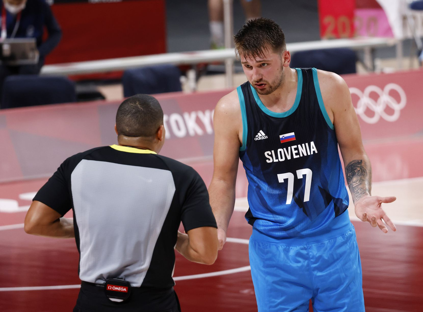 Slovenia's Luka Doncic (77) talks to a referee in the second half of play in a game against Argentina during the postponed 2020 Tokyo Olympics at Saitama Super Arena on Monday, July 26, 2021, in Saitama, Japan. Slovenia defeated Argentina 118-100. (Vernon Bryant/The Dallas Morning News)