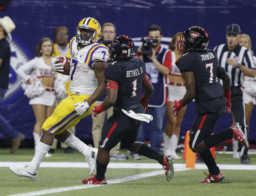LSU running back Leonard Fournette (7) looks over his shoulder at Texas Tech defensive backs Jah'Shawn Johnson (7) and Nigel Bethel (1) as he scores on a 44-yard touchdown during the first half of the Texas Bowl NCAA college football game Tuesday, Dec. 29, 2015, in Houston.