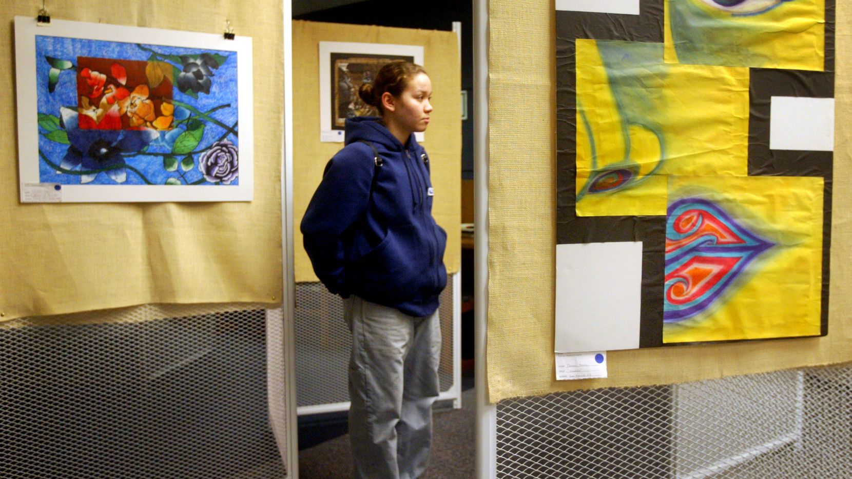 In this 2005 file photo, Angela McPherson examined artwork at the Richardson Civic Arts Society's high school art exhibit at the Richardson Public Library.