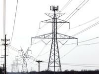 Large electrical transmission lines cross through South Arlington, Wednesday, February 17, 2021. Rolling power outages have disrupted service to customers following this weeks snow storm and deep freeze. (Tom Fox/The Dallas Morning News)