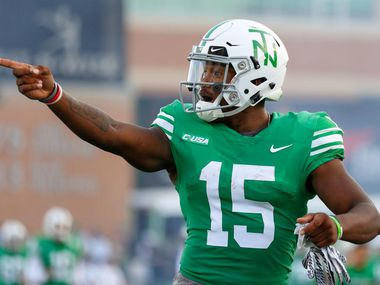 North Texas running back Tre Siggers points at a group of UTSA players before the Mean Green's win over the Roadrunners last season.
