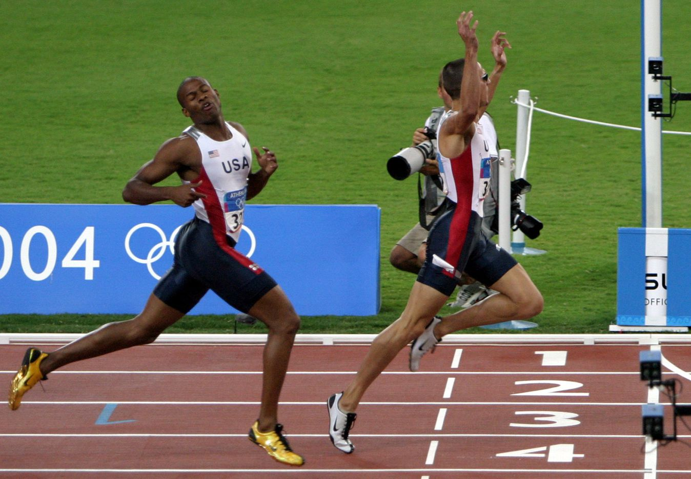 2004 Summer Olympic Games: Jeremy Wariner of the U.S. (R) beats teammate Otis Harris to the finish line to win the men's 400m final during track and field competition at the 2004 Summer Olympic Games in Athens, Greece, on Aug. 23, 2004.