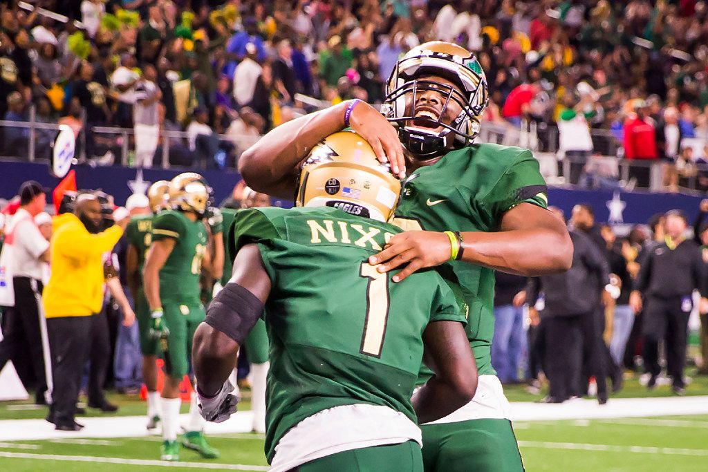 DeSoto wide receiver KD Nixon (1) celebrates with quarterback Shawn Robinson (3) after scoring on a 28-yard touchdown pass during the first half of the UIL Class 6A Division II state football championship football game against Cibolo Steele at AT&T Stadium on Saturday, Dec. 17, 2016, in Arlington. (Smiley N. Pool/The Dallas Morning News)