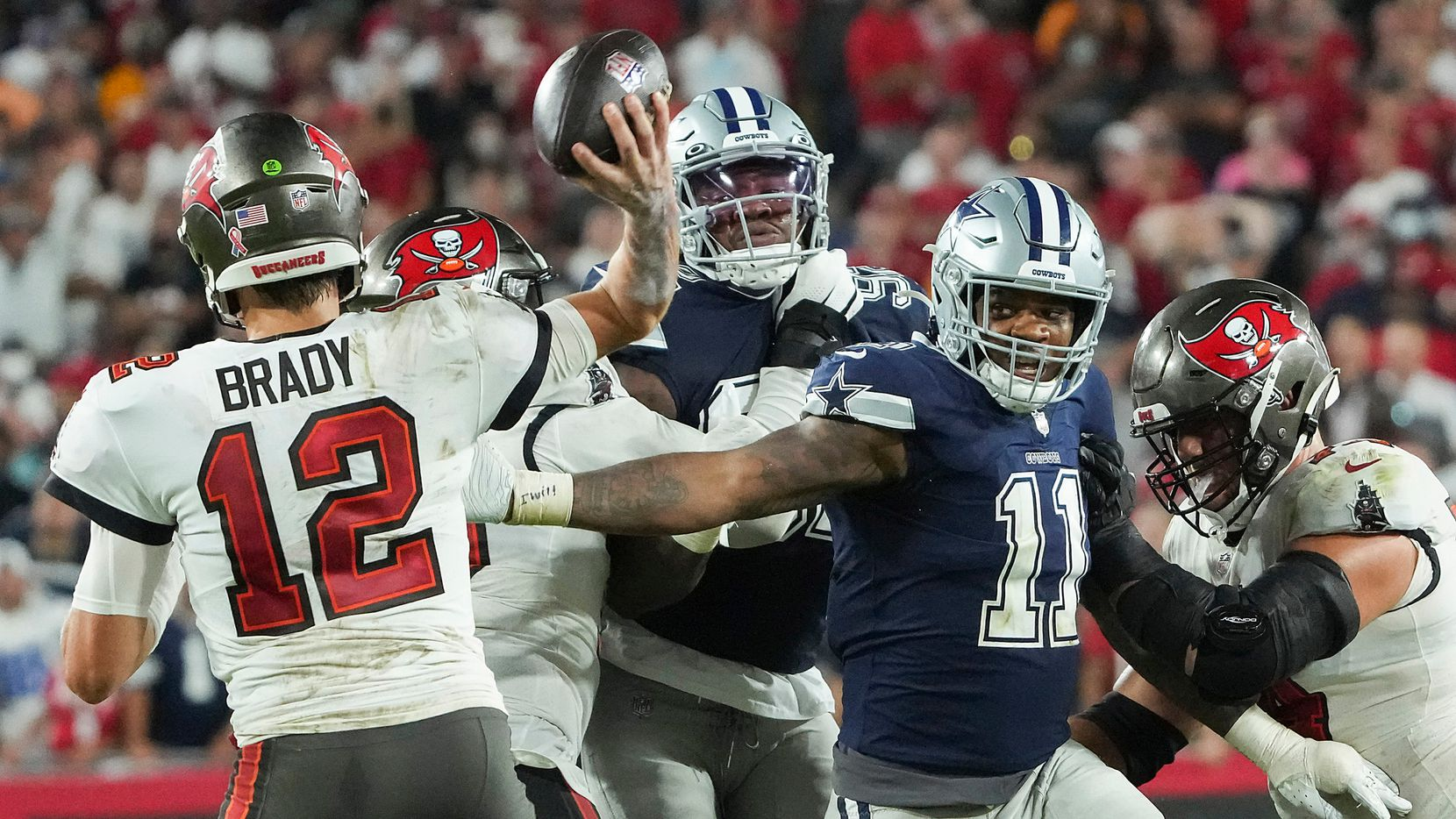 Tampa Bay Buccaneers quarterback Tom Brady (12) throws a pass under pressure from Dallas Cowboys linebacker Micah Parsons (11) during the second half of an NFL football game at Raymond James Stadium on Thursday, Sept. 9, 2021, in Tampa, Fla. The  Buccaneers won the game 31-29.