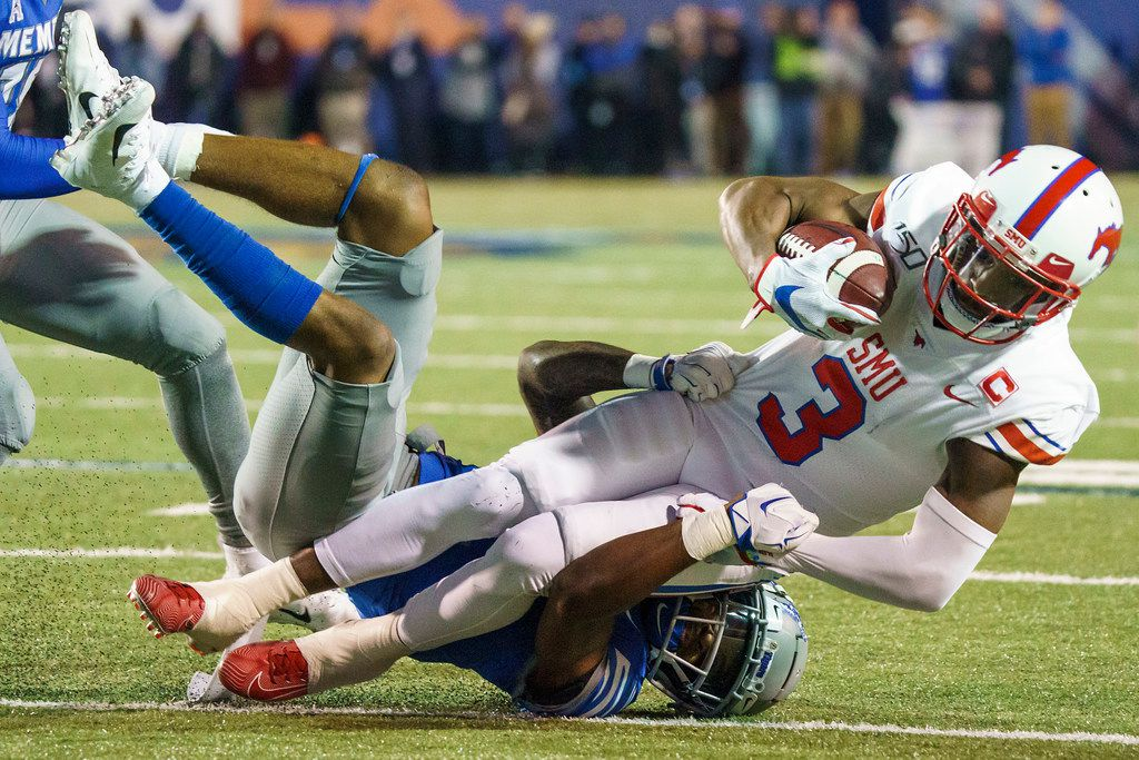 SMU wide receiver James Proche (3) in brought down by Memphis defensive back T.J. Carter (2) defends during the first half of an NCAA football game at Liberty Bowl Memorial Stadium on Saturday, Nov. 2, 2019, in Memphis, Tenn. (Smiley N. Pool/The Dallas Morning News)