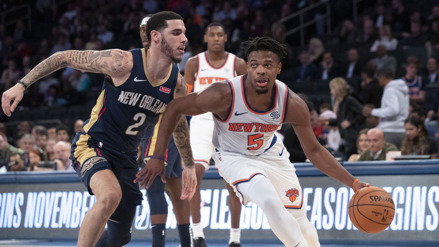 New York Knicks guard Dennis Smith Jr. (5) /drives to the basket against New Orleans Pelicans guard Lonzo Ball (2) during the second half of a preseason NBA basketball game, Friday, Oct. 18, 2019, at Madison Square Garden in New York. The Pelicans won 117-116. (AP Photo/Mary Altaffer)
