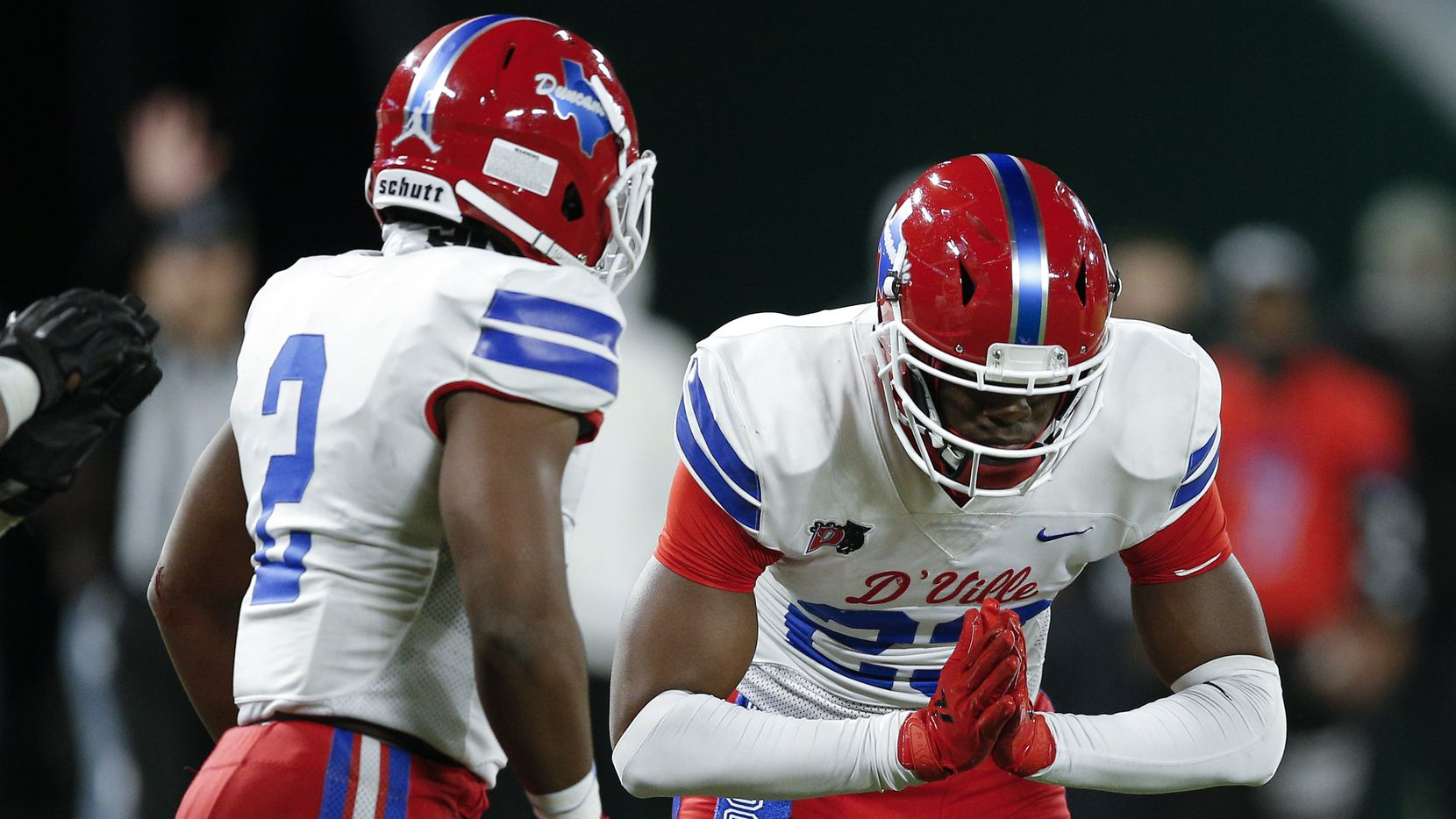 Duncanville junior linebacker Jordan Crook (2) looks on as junior defensive end Omari Abor (23) celebrates a sack during the first half of a Class 6A Division I Region II final high school football game against DeSoto, Saturday, January 2, 2021.