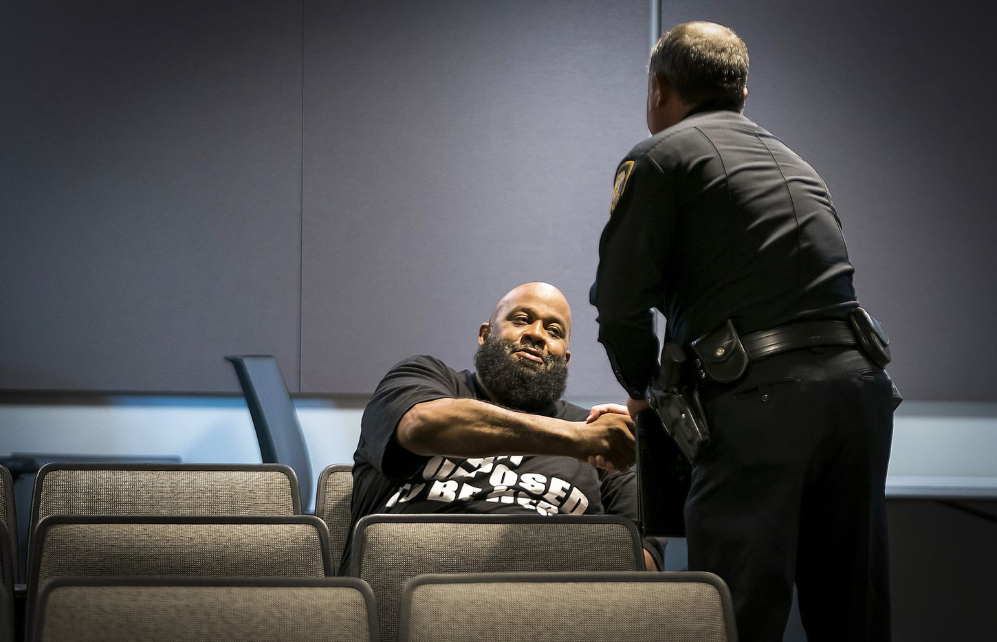 Fort Worth police Lt. Brandon OÕNeil shakes hands with Roger Foggle after addressing a news conference regarding the shooting of Atatiana Jefferson at the Bob Bolen Public Safety Complex on Sunday, Oct. 13, 2019, in Fort Worth.