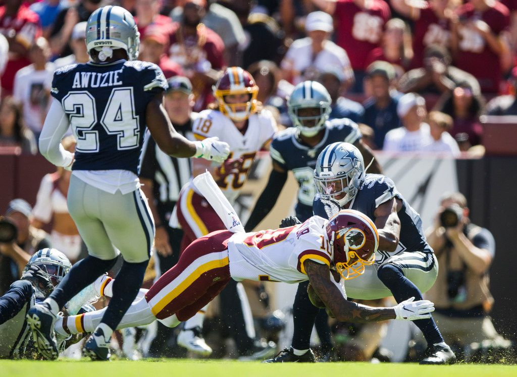 Dallas Cowboys cornerback Byron Jones (31) tries to stop Washington Redskins wide receiver Paul Richardson (10) from diving in the end zone for a touchdown during the third quarter of an NFL game between the Dallas Cowboys and the Washington Redskins on Sunday, September 15, 2019 at FedExField in Landover, Maryland.