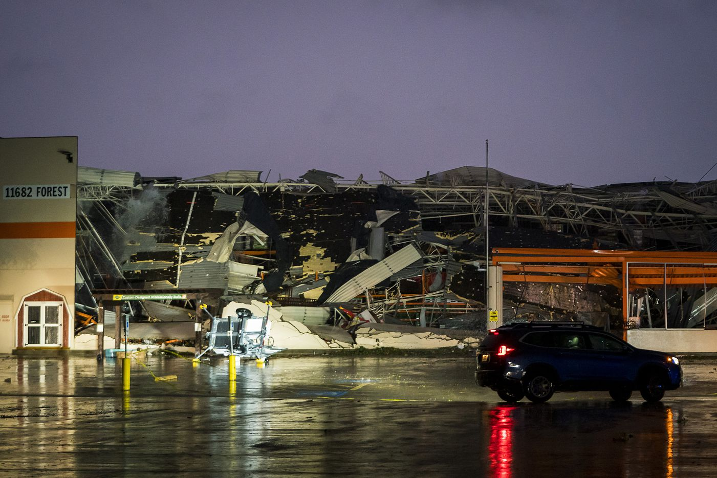 Tornado damage to the Home Depot store near the intersection of Forest and North Central Expressway in the early morning hours on Monday, Oct. 21, 2019, in Dallas.