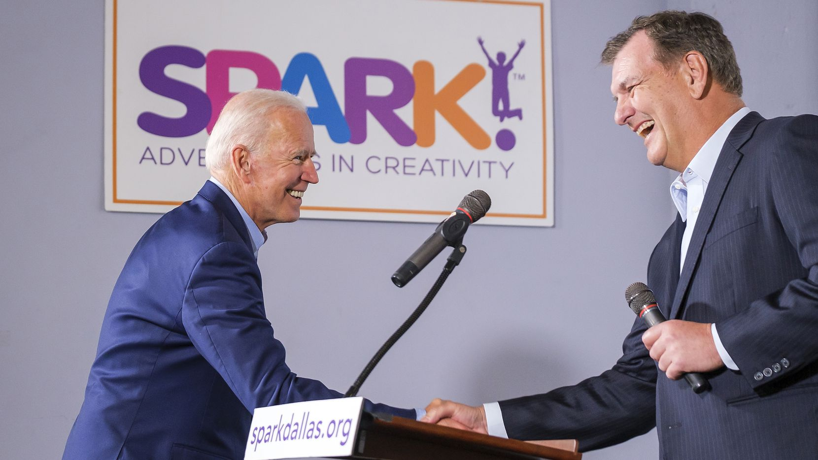 Democratic presidential candidate Joe Biden (left) shakes hands with Dallas Mayor Mike Rawlings as he is introduced to speak to participants in the Dallas Mayor's Intern Fellows Program as during a campaign event at SPARK! on Wednesday, May 29, 2019, in Dallas. (Smiley N. Pool/The Dallas Morning News)