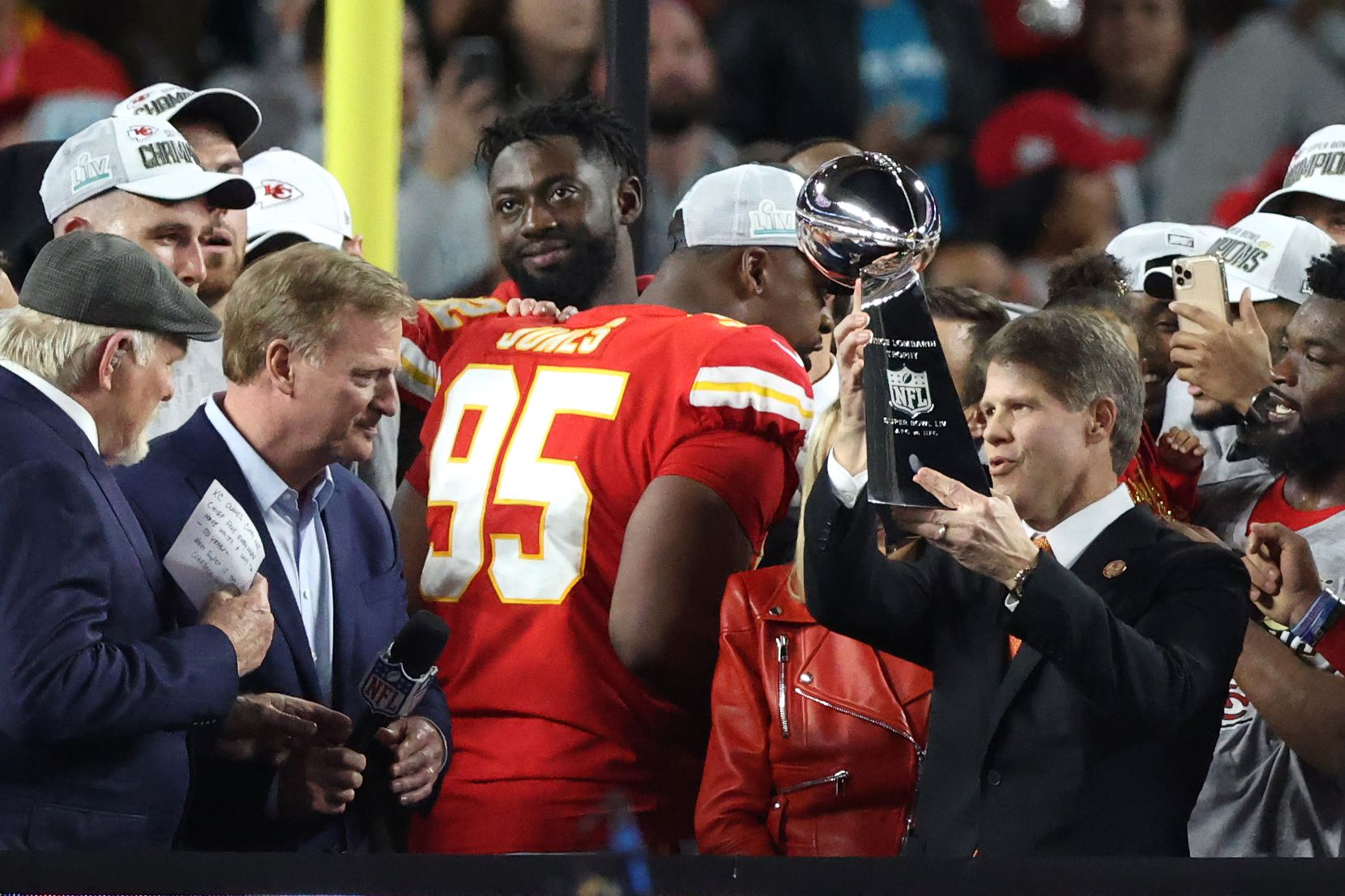 Clark Hunt raises the Super Bowl trophy after his Kansas City Chiefs won the NFL's championship game to start the year.