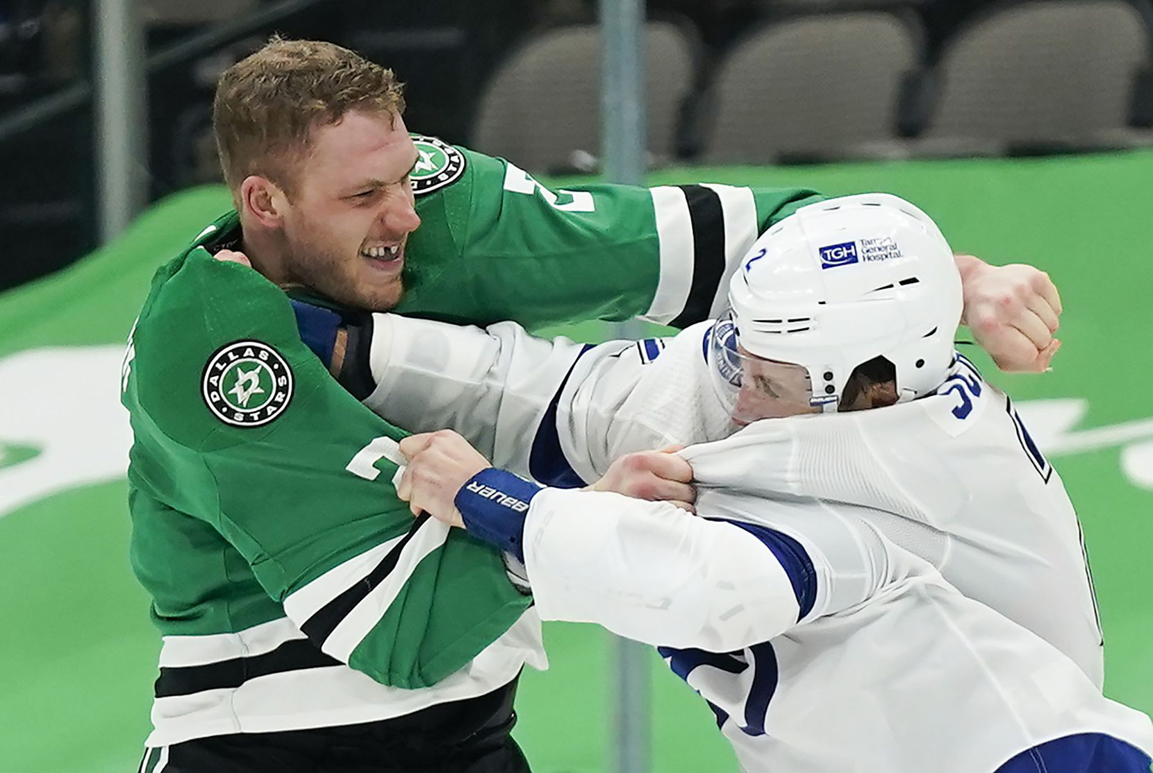 Dallas Stars defenseman Jamie Oleksiak (left) fights with Tampa Bay Lightning defenseman Luke Schenn during the second period of an NHL hockey game at the American Airlines Center on Thursday, March 25, 2021, in Dallas.