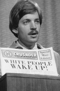 Duke talks to members of the press in Denver in 1977. (AP photo)