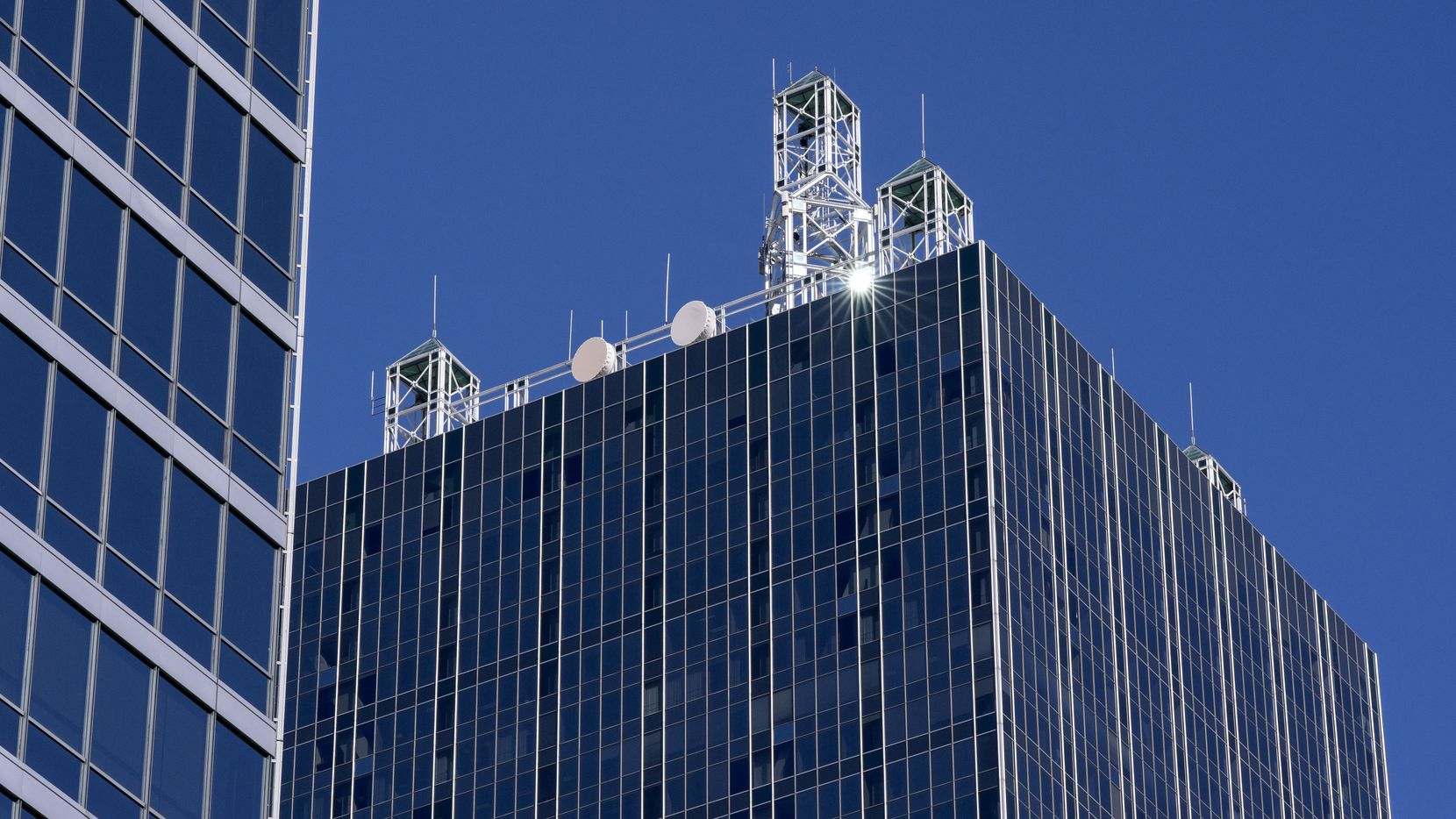 The top of Renaissance Tower gleams in the sun. It's one of downtown Dallas' biggest buildings.