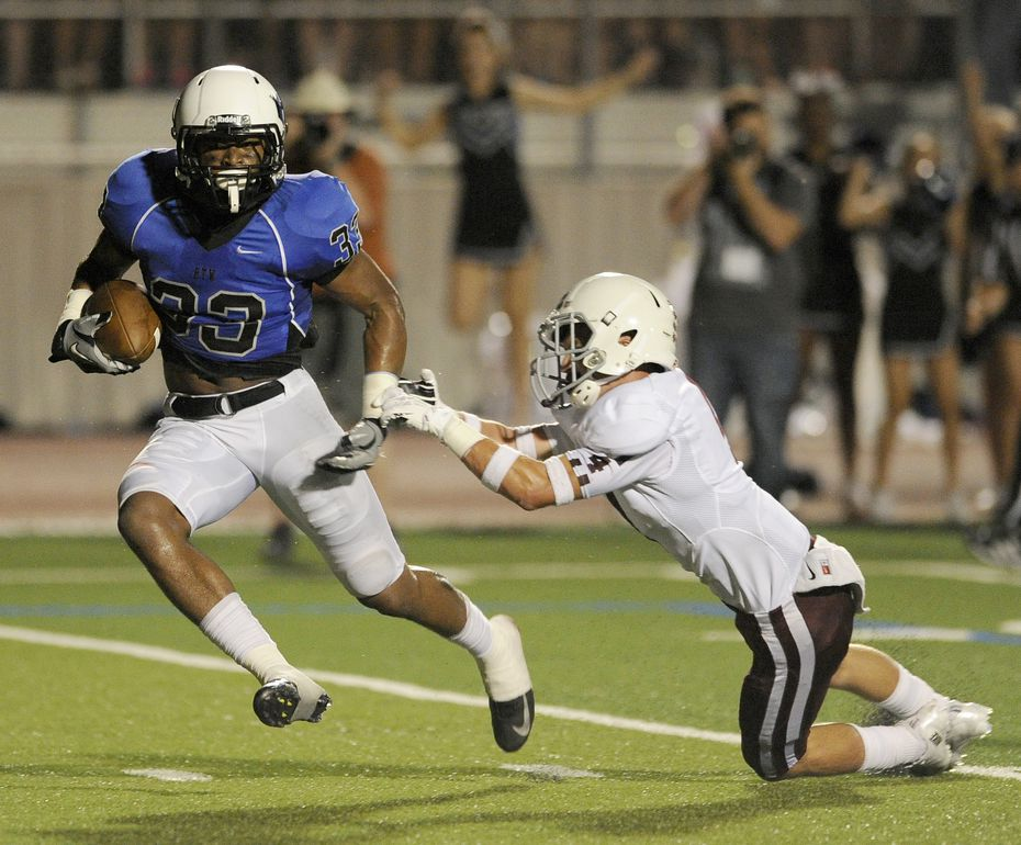 Hebron's Jamal Adams  (33) runs through a tackle attempt by Plano's Collin Carpenter (4) for a second quarter touchdown during a Class 5A high school football game, Friday, Sept. 27, 2013 in Carrollton, Texas.