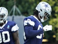 Dallas Cowboys defensive end Randy Gregory (94) laughs between drills with teammate DeMarcus Lawrence (90)during the team's practice at The Star on Wednesday, Oct. 7, 2020, in Frisco.