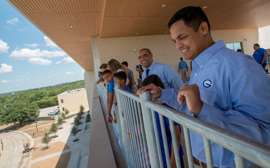 Grand Prairie High School Principal Lorimer Arendse, surrounded by students, faculty, administrators, friends and family, looks out from the balcony of the school's new four-story learning tower during a tour of the new facility on Aug. 20.