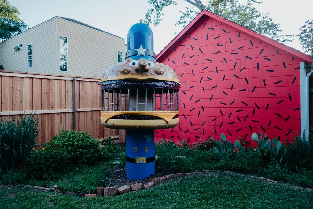 A piece of vintage McDonald's play equipment stands out in the backyard of The Slater.