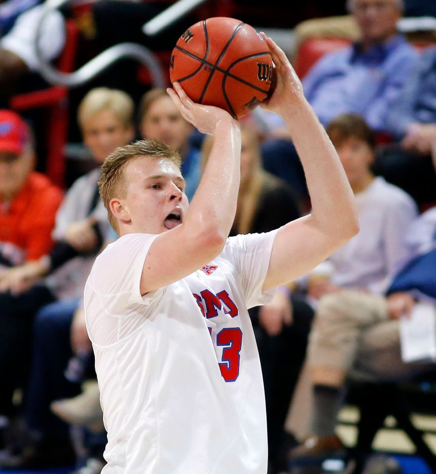Southern Methodist Mustangs forward Harry Froling (13) puts up and makes a three point shot against the Eastern Michigan Eagles during the second half at Moody Coliseum in University Park, Texas, Sunday, November 13, 2016. The Mustangs won, 91-64. (Tom Fox/The Dallas Morning News)