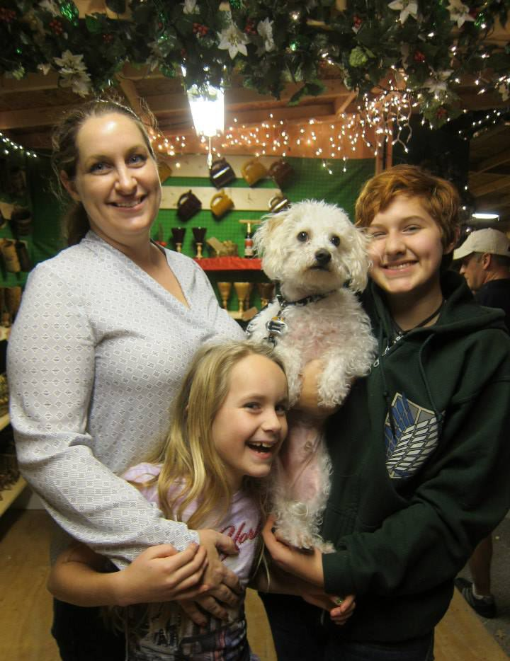 Scrappy checked out the shops with (from left) Beth, Kathryn and Elena Perry of Amarillo at the Texas Christkindl Market in 2014.