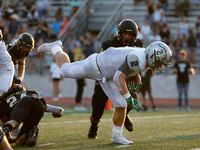 Frisco Reedy linebacker Will Harbour (2) stumbles across the goal line for a first quarter touchdown against The Colony at Tommy Briggs Cougar Stadium in The Colony, Texas, Friday, September 6, 2019.