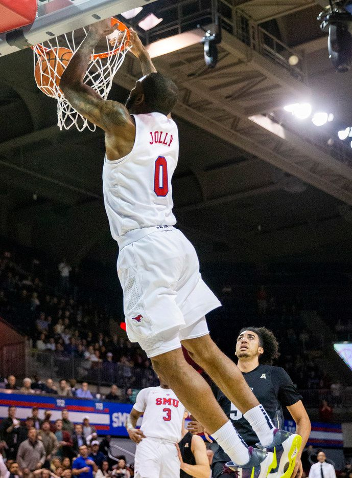 Southern Methodist Mustangs guard Tyson Jolly (0) goes up for a slam dunk in the final moments of an NCAA basketball game between the SMU Mustangs and the University of Central Florida Knights at Moody Coliseum in University Park, Texas, on Wednesday, Jan. 8, 2020.