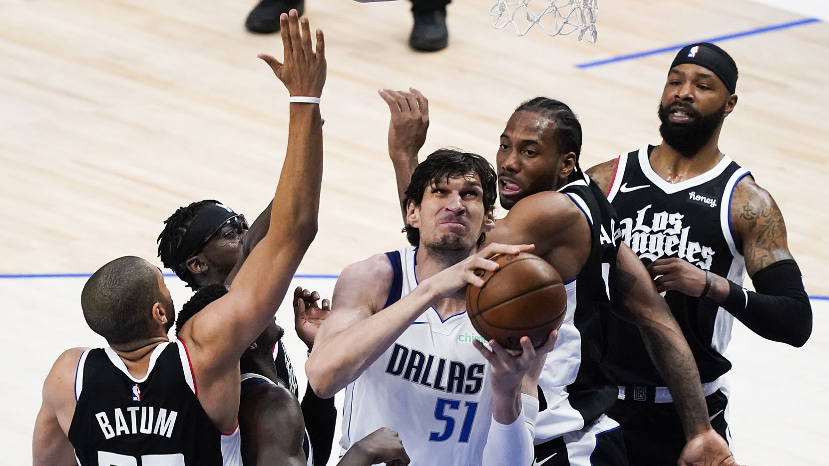 Dallas Mavericks center Boban Marjanovic (51) goes to the basket as LA Clippers forward Kawhi Leonard (2) defends during the first quarter of an NBA playoff basketball game at American Airlines Center on Sunday, May 30, 2021, in Dallas.